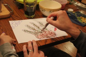 father making hand turkey