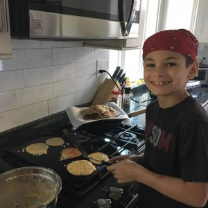 Jennifer Robins - son making pancakes